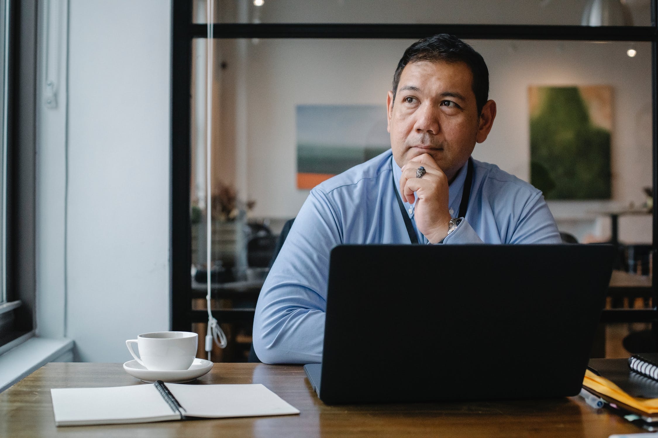 Lawyer working on laptop on integrated practice management software